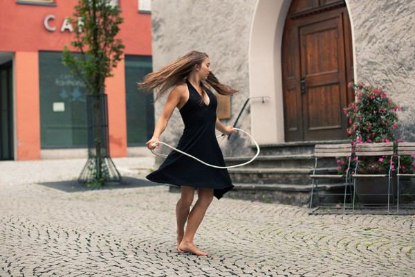 Dance with lasso in front of cafe