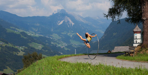 Cyr wheeling on a mountain road