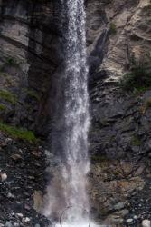 Cyr wheel under a tall waterfall