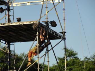 Acrobat transporting violin at babel remix performance