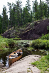 Canoe by a cliff in BWCAW