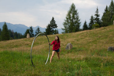 Catching cyr wheel in the meadow