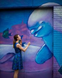 Feeding a flower to Beluga