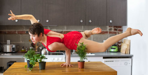 Handbalancing in red on kitchen counter