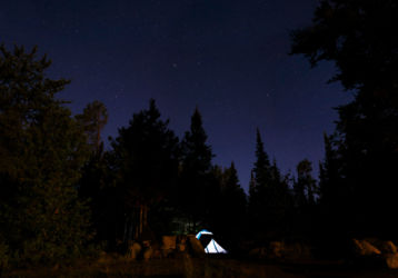 Illuminated tent among stars in BWCAW