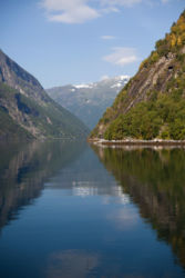 Mountain reflection in Geiranger fjord