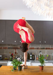 One armed handstand in red