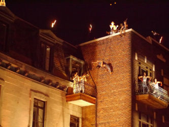 Rappelling of building with violin at babel remix performance