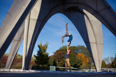 High arms hand stand with arch under sculpture