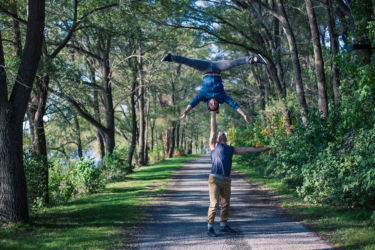 One armed headstand in the woods