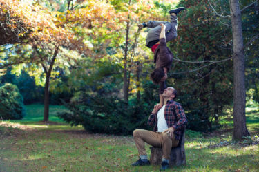 One hand handstand sitting on tree stump